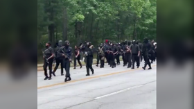 'We're in your house': Armed black protesters march through Georgia Confederate park